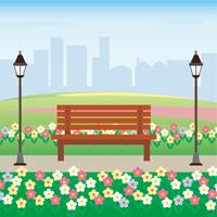 花が咲いている公園のベンチ